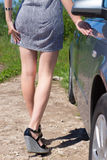 Sexy female legs near the car. Stock Photography