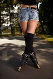 Sexy female legs in roller skates Royalty Free Stock Image
