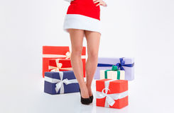 Sexy female legs in santa claus cloth with present boxes Stock Image