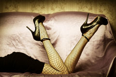 Sexy female legs in shoes Royalty Free Stock Images