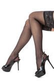 Sexy female legs in stilettos and stockings Royalty Free Stock Images