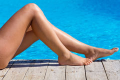 Sexy female legs at swimming pool Royalty Free Stock Image