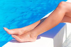 female legs swimming pool Royalty Free Stock Photo