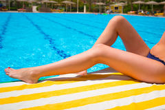 Sexy female legs at the swimming pool Stock Image