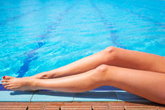 Sexy female legs at the swimming pool Royalty Free Stock Photo