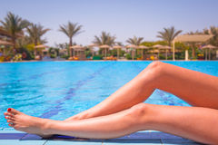 Sexy female legs at the swimming pool Stock Images