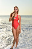 Sexy female lifeguard on beach Royalty Free Stock Photography
