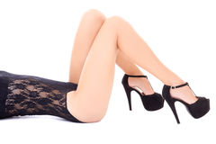 Sexy female long legs in shoes on heels isolated on white Royalty Free Stock Photography