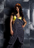 Sexy female miner worker with pickaxe, in coveralls over his naked body Stock Photo