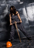 female miner worker with pickaxe, in coveralls over his naked body. erotic industry concept Royalty Free Stock Image