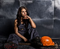 Sexy female miner worker with pickaxe, in coveralls over his naked body. erotic industry concept Stock Photos