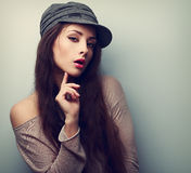 Sexy female model in cap flirting. Vintage closeup portrait Royalty Free Stock Images