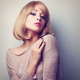 Sexy female model posing with blond short hair style. Color tone Stock Photos