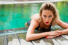 Female model posing in the pool Royalty Free Stock Image