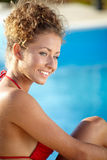 Sexy female model posing by the pool, outdoor portrait Stock Photos