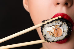 Sexy female mouth with roll Stock Photos
