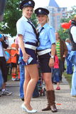 Female police officers in the street. Two police contestants of the police team of the city apeldoorn posing for the camera during the dragonboat races in the royalty free stock images