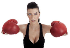 Sexy female posing with red boxing gloves Stock Image