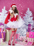 Sexy female santa claus. Female santa claus enjoy from christmas Stock Photos