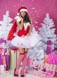 Sexy female santa claus Stock Photos