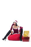 Sexy female Santa Claus posing with bag of gifts Royalty Free Stock Images