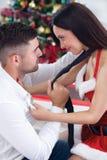 Female Santa seduces man on Christmas night. Couple in love on Christmas night stock photos