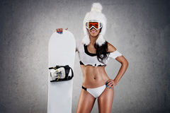 Sexy female snowboarder Stock Photography