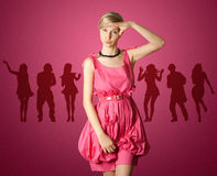 Sexy female stewardess in pink. Looking on camera, with hand near her head Royalty Free Stock Photography