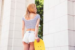 Sexy female teenager with skateboard Royalty Free Stock Photography
