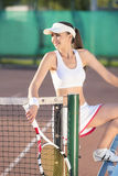 Sexy Female Tennis Player on Court Royalty Free Stock Image