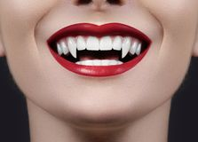 Female Vampire Lips. Monster Smile. Halloween Style with Red Blood Makeup Lip. Masquerade Look with Terrible Royalty Free Stock Image