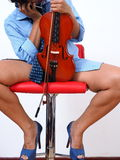 Sexy female violinist with undone necktie Stock Image