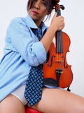 Sexy female violinist with undone necktie Stock Photos