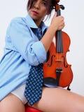 Sexy female violinist with undone necktie Stock Photos