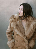 Sexy female in a warm winter jacket Royalty Free Stock Photo