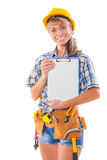 Sexy female worker showing clipboard with blank sheet Royalty Free Stock Photography