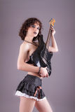 Sexy fetish girl with guitar, studio shot over Stock Photos
