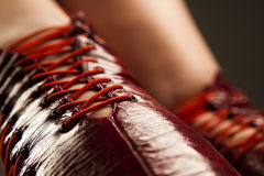 Fetish red boots. Close-up of female legs in fetish red boots stock images