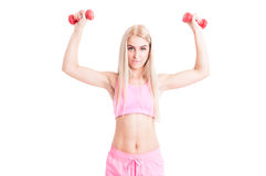 Sexy fit female fitness trainer lifting weights Stock Photos
