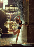 Sexy, fit woman in a fountain Stock Photos