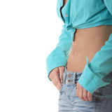 Sexy, fit woman in jeans, with naked stomach. Isolated on white Stock Photo
