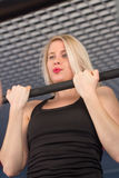 Sexy fit woman performing pull ups in a bar Royalty Free Stock Photos