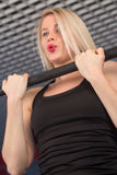 Sexy fit woman performing pull ups in a bar.  Stock Photography