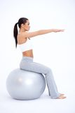 Fit Woman Sitting on Big Exercise Ball Royalty Free Stock Image
