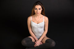 Sexy fit woman sitting on the floor Stock Photos