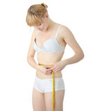 Sexy, fit, young woman measuring Royalty Free Stock Images