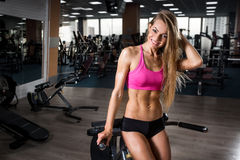 Fitness beautiful young girl smiling and resting after squat exercises Stock Images