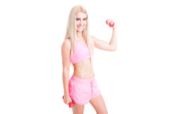 Sexy fitness female with slim body holding weights Stock Photos