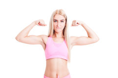 fitness girl flexing arms Royalty Free Stock Photography