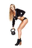 Sexy fitness model with kettlebell. Sexy blonde woman with kettlebell, isolated on white Royalty Free Stock Photography